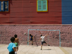 October 1995, Buenos Aires, Argentina --- Children playing soccer in the street in the Boca district of Buenos Aires. --- Image by © Jean-Yves Ruszniewski/TempSport/Corbis